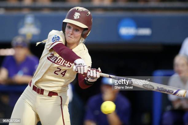 Sydney Sherrill of the Florida State Seminoles hits a double against the Washington Huskies during the Division I Women's Softball Championship held...