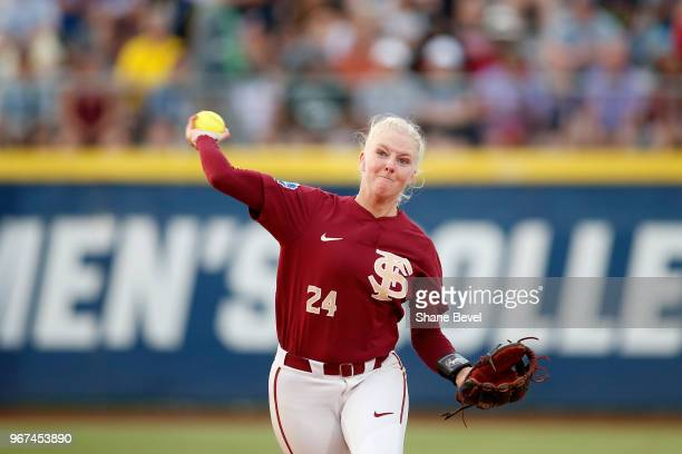Sydney Sherrill of the Florida State Seminoles throws to first against the Washington Huskies during the Division I Women's Softball Championship...