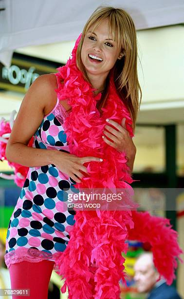 Sydney socialite Amy Erbacher enjoys herself on a bed in Sydney's central shopping precinct 18 September 2007 during a fun promotion to raise funds...