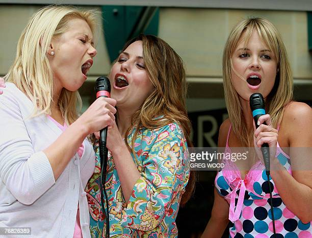 Sydney socialites Holly Brisley Toni Pearen and Amy Erbacher sing together in Sydney's central shopping precinct 18 September 2007 during a fun...