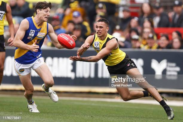 Sydney Stack of the Tigers handpasses the ball during the VFL Grand Final match between the Richmond Tigers and Williamstown at Ikon Park on...