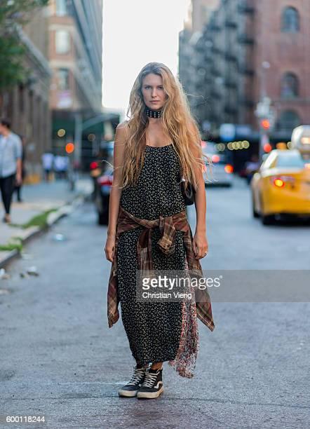 Sydney Stutterheim wearing a green dress and Vans outside R13 on September 7 2016 in New York City