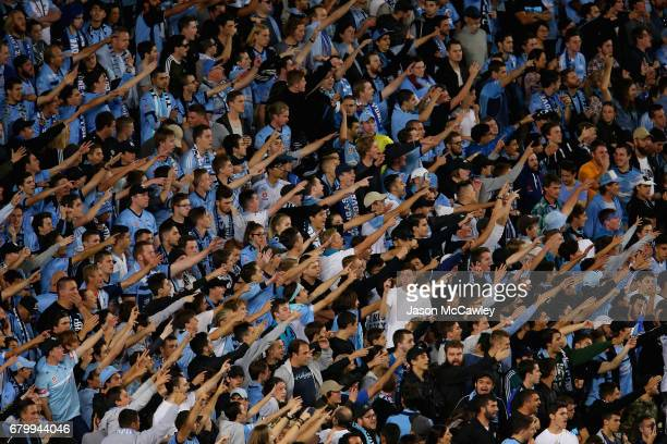 Sydney supporters in The Cove cheer during the 2017 ALeague Grand Final match between Sydney FC and the Melbourne Victory at Allianz Stadium on May 7...