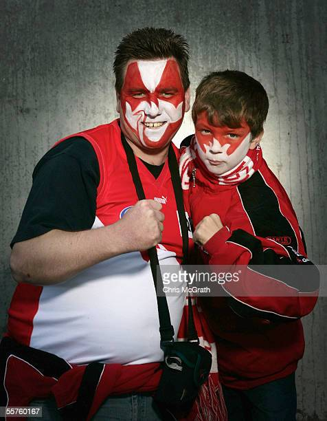 Sydney Swans fans pose for a portrait prior to the start of the 2005 AFL Grand Final between the Sydney Swans and the West Coast Eagles held at the...