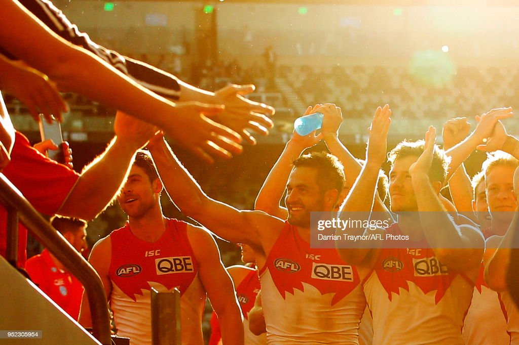 Sydney Swans players acknowledge their fans afte the round six AFL match between the Geelong Cats and Sydney Swans at GMHBA Stadium on April 28, 2018 in Geelong, Australia.