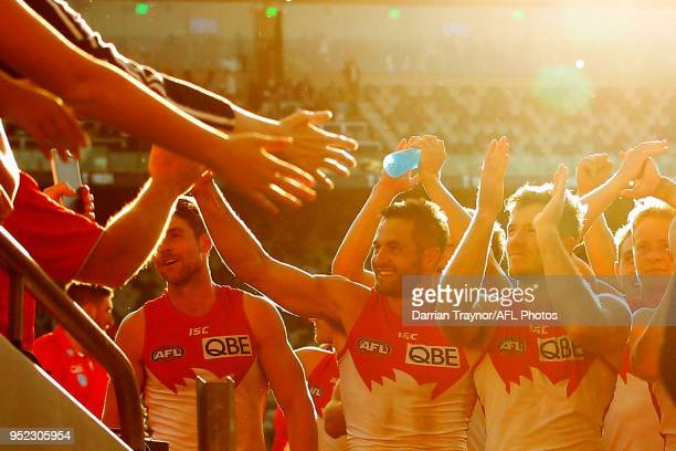 Sydney Swans players acknowledge their fans afte the round six AFL match between the Geelong Cats and Sydney Swans at GMHBA Stadium on April 28 2018...