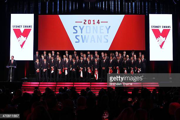 Sydney Swans players stand on stage after receiving their 2014 Sydney Swans guernseys during the Sydney Swans AFL guernsey presentation and Hall of...