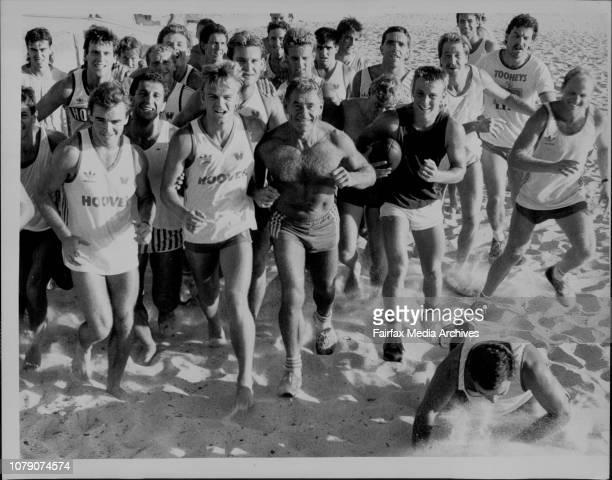 Sydney Swans training on Bronte beach todayDavid Bolton gives Greg Williams a friendly ShoveA bare chested Tom Hafey leads on their beach runWarwick...