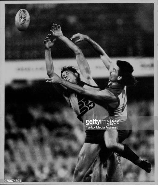 Sydney Swans Vs Brisbane bears at the SCG Sydney Swans half forward Tony Morwood right and his Brisbane Bears opponent flail harmlessly at the ball...