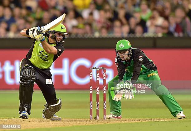 Sydney Thunder cricketer Michael Hussey plays a shot as Melbourne Star wicketkeeper Peter Handscomb looks on during the T20 Big Bash League cricket...