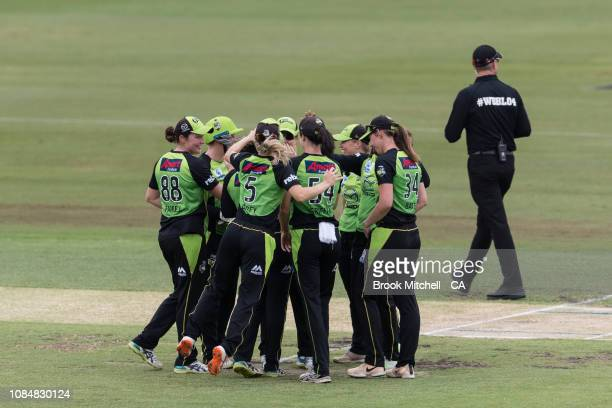 Sydney Thunder players celebrate a wicket during the Women's Big Bash League Semi Final against the Brisbane Heat on January 19 2019 in Sydney...