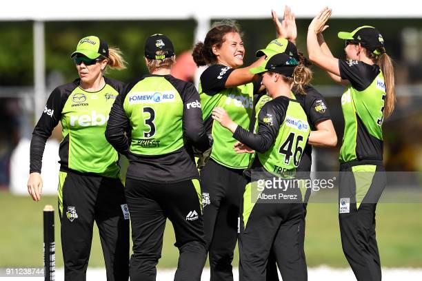 Sydney Thunder players celebrate after Kirby Short of the Heat was caught by Rachel Priest during the Women's Big Bash League match between the...
