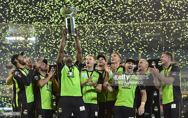 Sydney Thunder players celebrate winning the T20 Big Bash League cricket final between the Melbourne Stars and Sydney Thunder at the Melbourne...