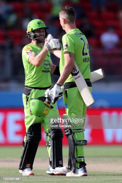 Sydney Thunder's Chris Morris and Callum Ferguson celebrate winning the Big Bash League match between the Sydney Thunder and the Perth Scorchers at...