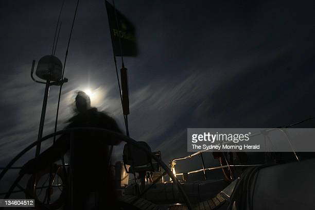 Sydney to Hobart 2007 John Dwyer sails by moonlight early in the morning at the helm of Helsal IV after the first night's journey of the 2007 Sydney...