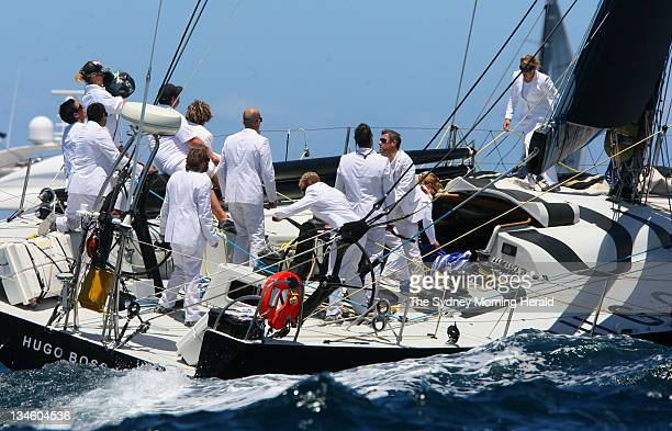 Sydney to Hobart 2007 The crew of super maxi Hugo Boss II get to work wearing white suits at the start of the 2007 Sydney to Hobart Yacht Race This...