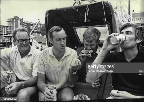 Sydney to Hobart yacht race preparations at CYCCrew of 36 ft sloop Carol Anne form NZ enjoy Christmas dinner on board left Tig Lowe Dave Anderson...