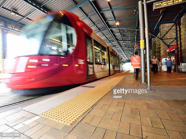 Sydney Tram, motion blurred at railway station. Motion blurred commuters.