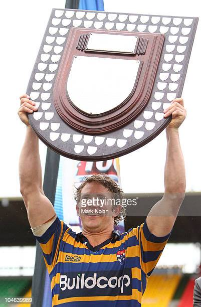 Sydney Uni captain Tim Davidson holds up the Shute Sheild after the Shute Shield Grand Final match between Randwick and Sydney University at Concord...