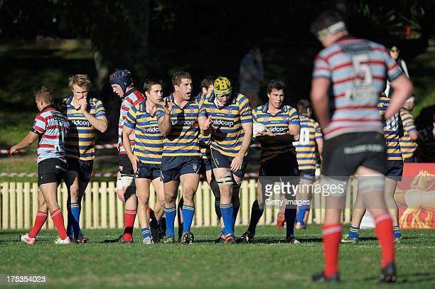 Sydney Uni celebrate after scoring during the round 16 Shute Shield match between Sydney Uni and Southern Districts at North Sydney Oval on August 3...