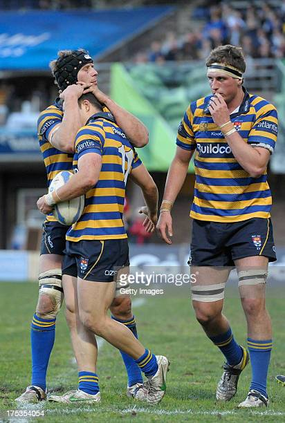 Sydney Uni players celebrate after scoring during the round 16 Shute Shield match between Sydney Uni and Southern Districts at North Sydney Oval on...