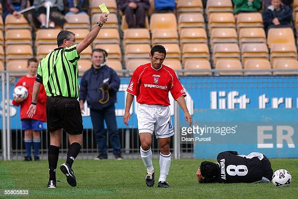 Sydney United player Gabriel Mendez gets the yellow card after a tackle on Kingz No8 Patricio Almendra during the National Soccer League match...