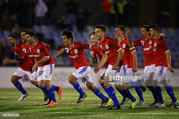Sydney United players celebrate winning a penalty shoot out during the FFA Cup match between Sydney United 58 FC and South Hobart at Sydney United...