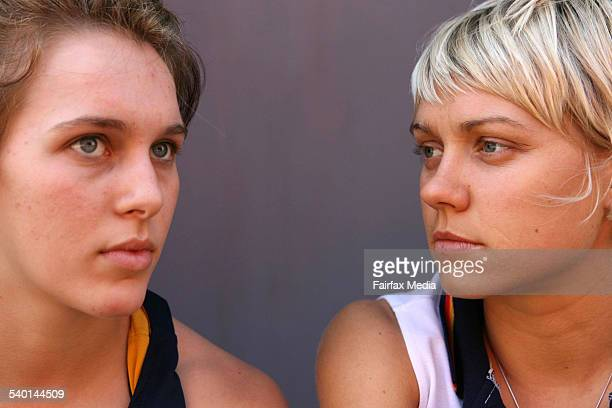 Sydney University Flames basketball player Mikaela Dombkins left and Erin Phillips from the WNBA side Connecticut Sun 25 November 2006 SHD SPORT...