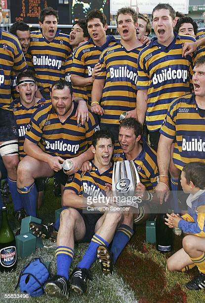 Sydney University players celebrate after winning the Tooheys New Cup Grand Final between Sydney University and Eastwood at Aussie Stadium October...
