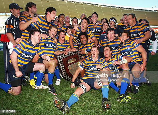 Sydney University players celebrate with the trophy after the Shute Shield Grand Final match between Sydney University and Randwick at Sydney...
