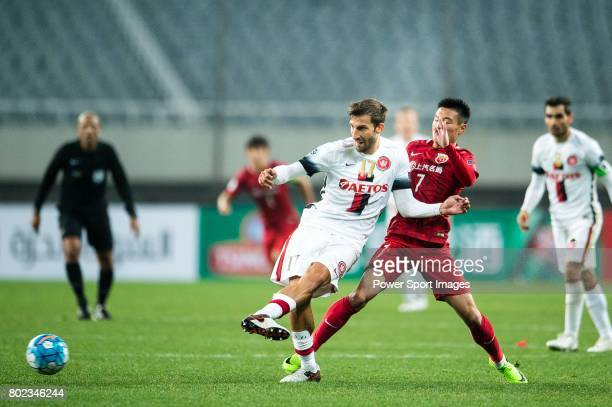 Sydney Wanderers Defender Haritz Borda fights for the ball with Shanghai FC Forward Wu Lei during the AFC Champions League 2017 Group F match between...