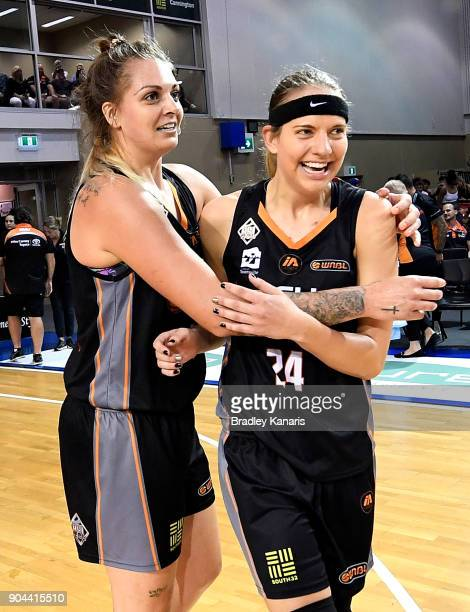 Sydney Wiese of the Fire celebrates victory with team mate Cayla George after game one of the WNBL Grand Final series between the Townsville Fire and...