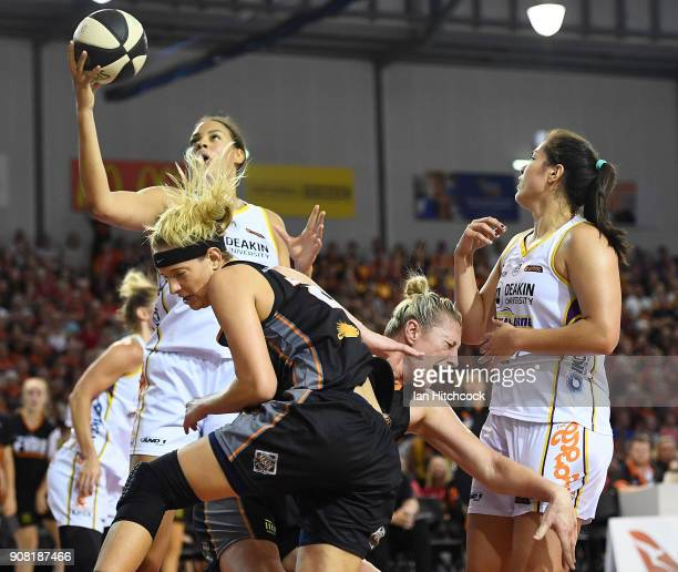 Sydney Wiese of the Fire collides with Suzy Batkovic of the Fire during game three of the WNBL Grand Final series between the Townsville Fire and...