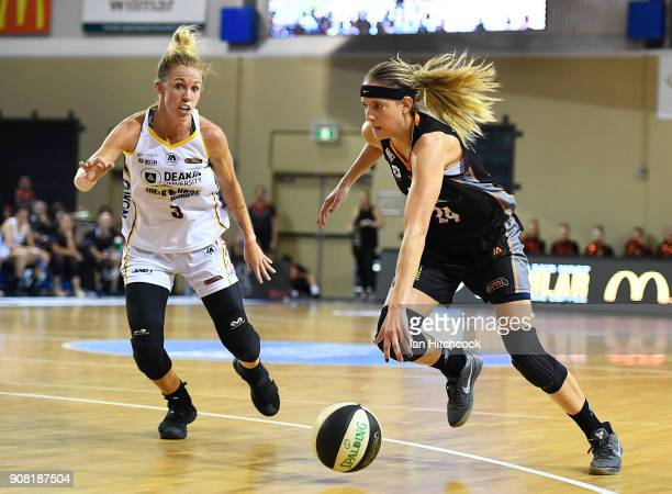 Sydney Wiese of the Fire drives to the basket past Brittany Smart of the Boomers during game three of the WNBL Grand Final series between the...