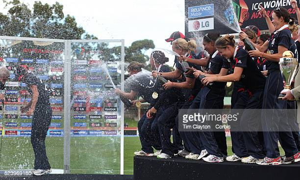 England Captain Charlotte Edwards is showered by champagne from team mates as she conducts a post match interview after the ICC Women's World Cup...