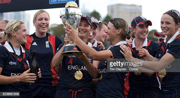 England's player of the match Nicky Shaw kisses the trophy after Englands's victory in the ICC Women's World Cup Cricket final between New Zealand...