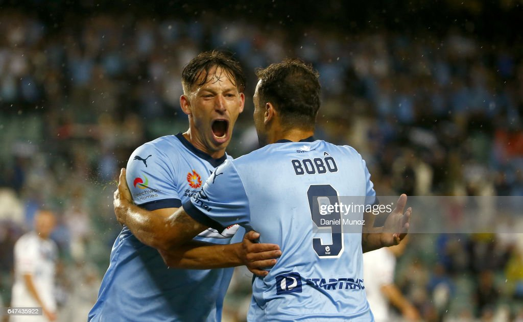 Sydney's Bobo (right) celebrates with teammate Filip Holosko after scoring during the round 22 A-League match between Sydney FC and Melbourne Victory at Allianz Stadium on March 3, 2017 in Sydney, Australia.