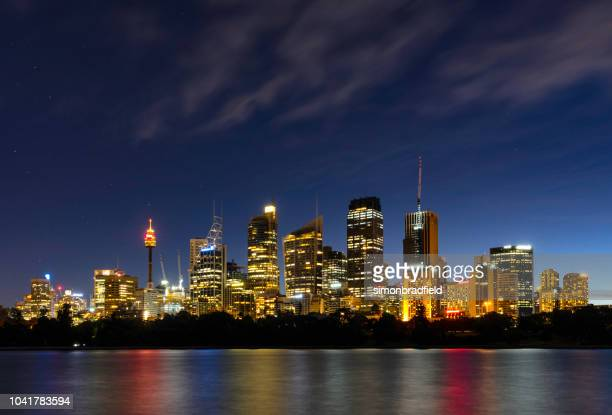 sydney's cbd at dusk - sydney harbour stock pictures, royalty-free photos & images