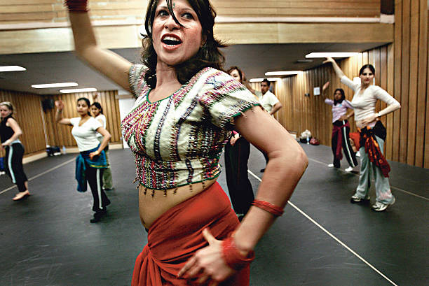 Sydney`s first Bollywood dance school teacher Farah Shah demonstrates some moves to her Thursday night class at Mango dance studio North Sydney NSW...