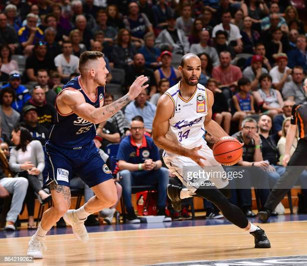 Sydneys Perry Ellis abd 36ers Mitch Creek during the round three NBL match between the Adelaide 36ers and the Sydney Kings at Titanium Security Arena...