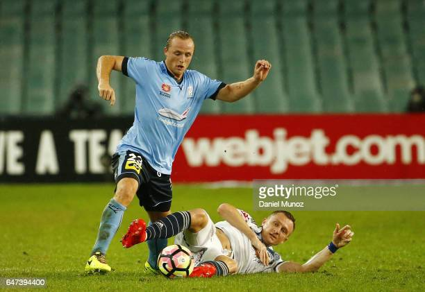 Sydney's Rhyan Grant fights for the ball against Melbourne's Besart Berisha during the round 22 ALeague match between Sydney FC and Melbourne Victory...