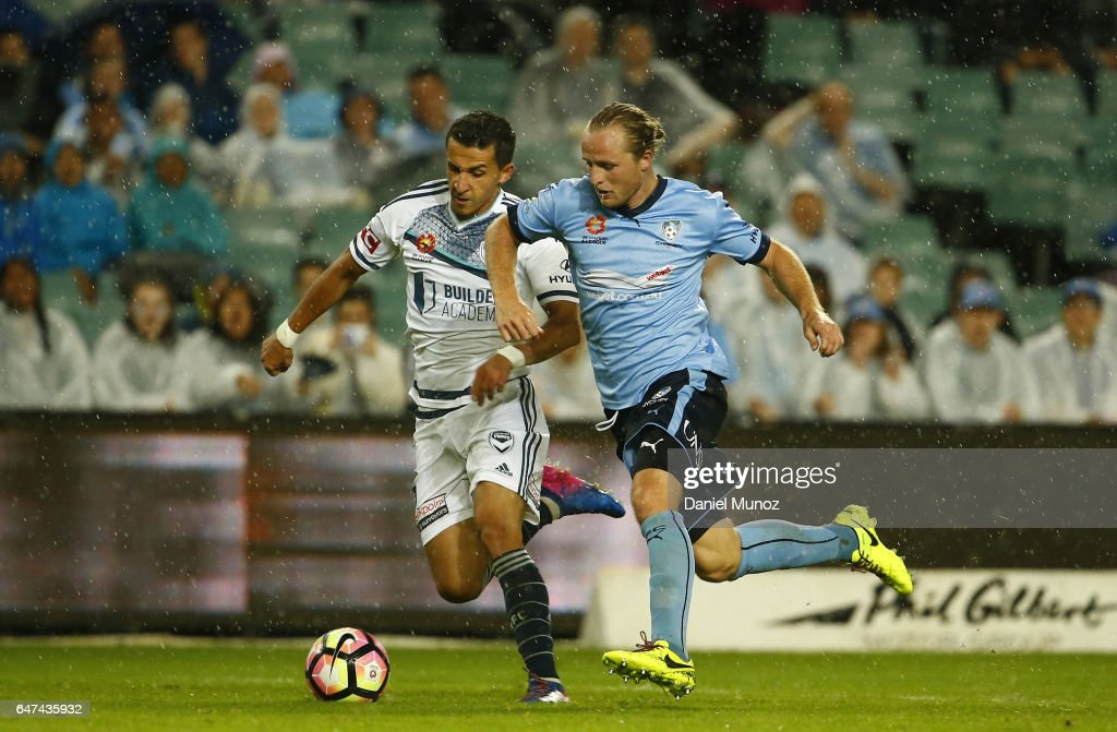 Sydney's Rhyan Grant fights for the ball against Melbourne's Daniel Georgievski during the round 22 A-League match between Sydney FC and Melbourne Victory at Allianz Stadium on March 3, 2017 in Sydney, Australia.
