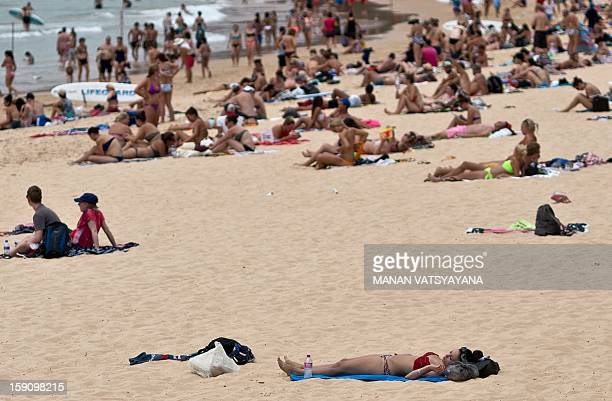 Sydneysiders and tourists gather on Manly beach in Sydney on January 8 2013 Authorities warned New South Wales state faced one of the highestrisk...