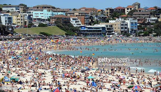 Sydneysiders celebrate New Year's Day and the warm summer weather by crowding onto the city's iconic Bondi Beach on January 1 2012 Only hours earlier...
