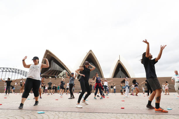AUS: Sydneysiders Take Part In Outdoor Dance Classes At Sydney Opera House