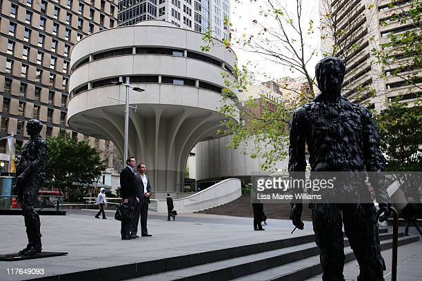 Sydneysiders walk amongst tar figures placed in the CBD to raise awareness about the damage smoking causes to the body at Martin Place on June 30,...