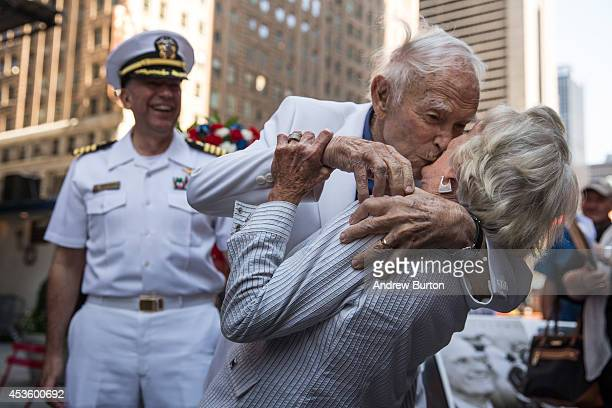 Sydnor Thompson age 90 kisses his wife Harriette Thompson age 91 while reenacting the Times Square Kiss photo taken by Alfred Eisenstaedt to mark the...