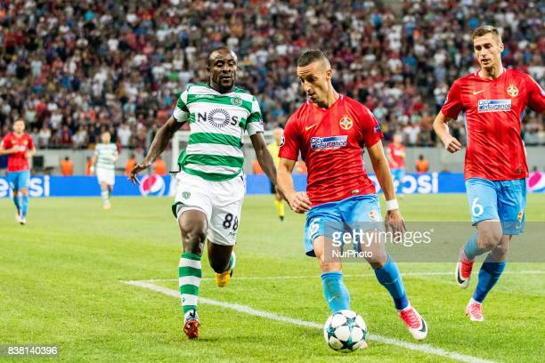 Sydou Doumbia of Sporting CP Lisbon and Marko Momcilovic of FCSB Bucharest during the UEFA Champions League 20172018 PlayOffs 2nd Leg game between...
