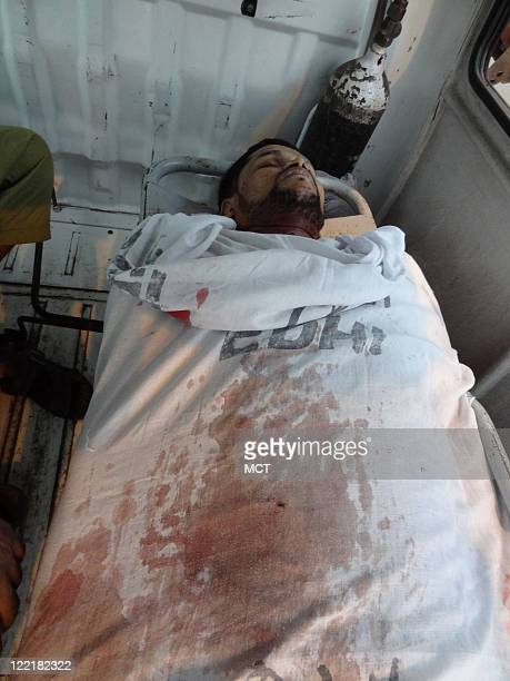 CONTENT Syed Allam lies dead in an ambulance in Karachi Pakistan that is run by the charity Edhi Gang violence is filling the morgue with young men...