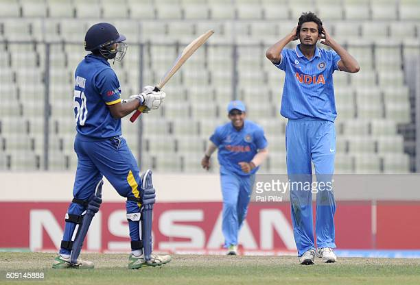 Syed Khaleel Ahmed of India reacts after claiming the wicket of Wanidu Hasaranga of Sri Lanka during the ICC U19 World Cup SemiFinal match between...